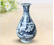 Antique blue and white dragon vase