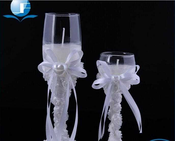 glass cup candle white flower around for wedding
