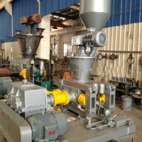 Two counter-rotating roller pellet mill