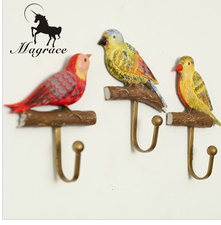 Antique three-piece bird sculpt hook