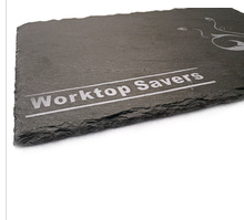 Natural slate placemat with carved logo