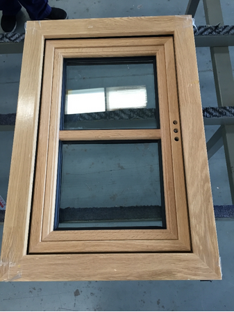 Small size aluminum clad wood window with outward opening