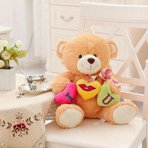 hugging heart bear doll