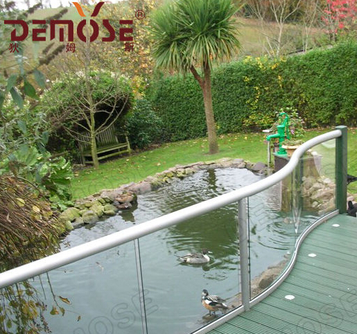 curved glass handrails with inox spigot for pond