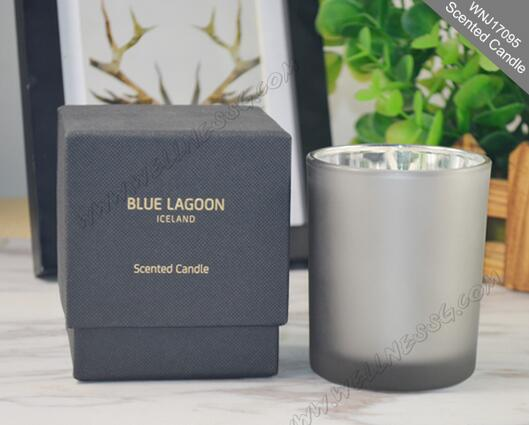 Modern design scented candle in glass jar