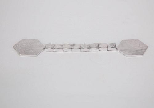 aluminum slug for collapsible tube electronics