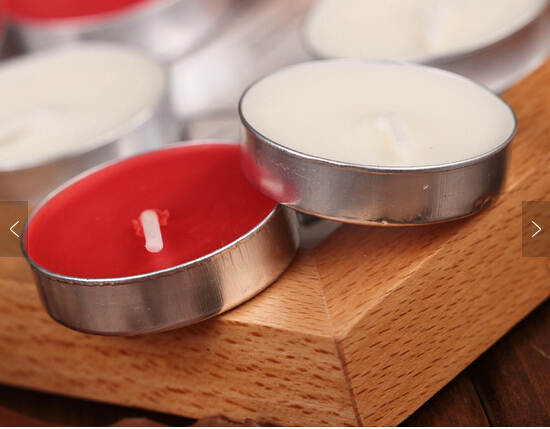 Custom fragrance colored tealight candle