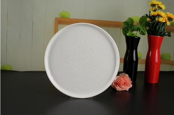 Beige ivory ceramic plate with bumping uneven surface